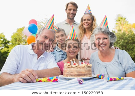 Family having birthday party in the park Stock photo © colematt