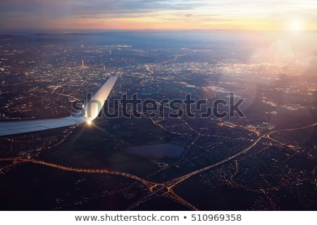 Aerial view of airplane flying in sky Stock photo © colematt
