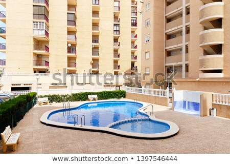 Typical high rise house with common swimming pool, Torrevieja, S Stock photo © amok