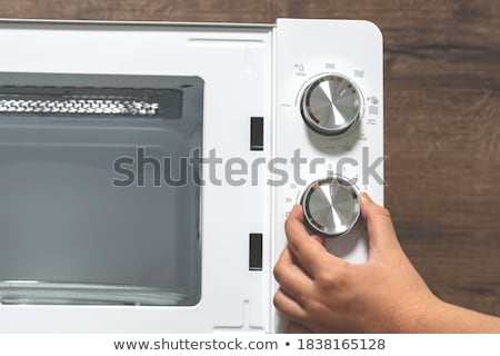 Girl Adjusting Temperature Of Microwave Oven Stock photo © AndreyPopov