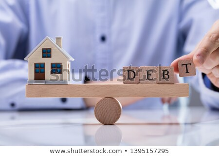 Szó adósság hinta egyensúlyoz modell ház Stock fotó © AndreyPopov