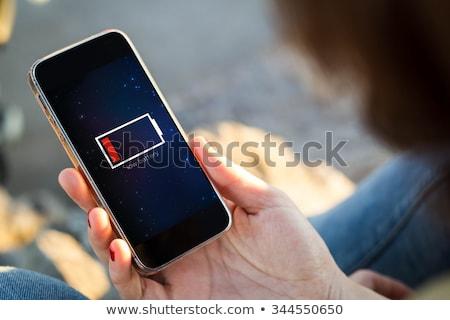 Hand telefoon laag batterij elegante mobieltje Stockfoto © ra2studio