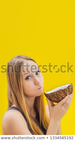 Young woman doing oil pulling over yellow background VERTICAL FORMAT for Instagram mobile story or s Stock photo © galitskaya
