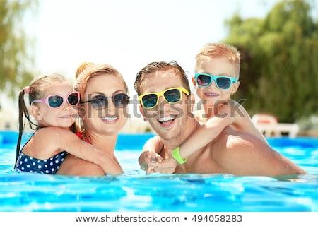 Mutlu aile yüzme havuzu gülen aile su parkı Stok fotoğraf © Kzenon