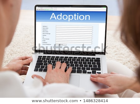 Couple Filling Adoption Paternity Registry In Laptop Stock photo © AndreyPopov