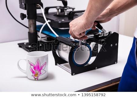 Photo stock: Printing On Mugs In Workshop