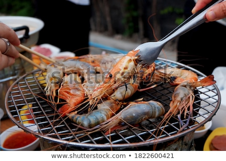 Grilled fresh seafood, food background Barbecue Cooking BBQ seafood on fire Stock photo © galitskaya