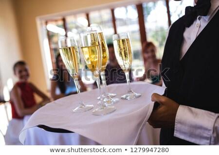 Serveuse champagne verres plateau restaurant Photo stock © wavebreak_media