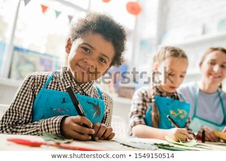 Feliz estudante highlighter olhando sessão secretária Foto stock © pressmaster