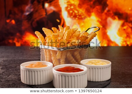 French fries meal with various sauces - in front of fireplace Stock photo © lightkeeper
