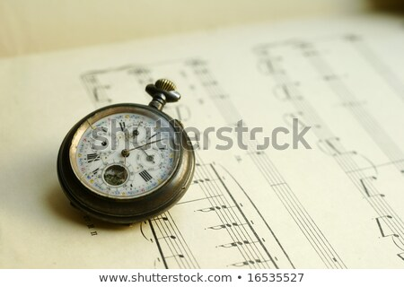 Antique pocket watch on the music sheet Stock photo © johnkwan