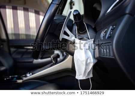 face mask hanging on the dashboard of a car Stock photo © nito