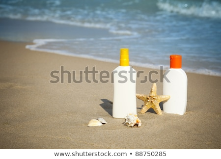 Suntan Lotion Flacons On The Beach With Copy Space Photo stock © Taiga