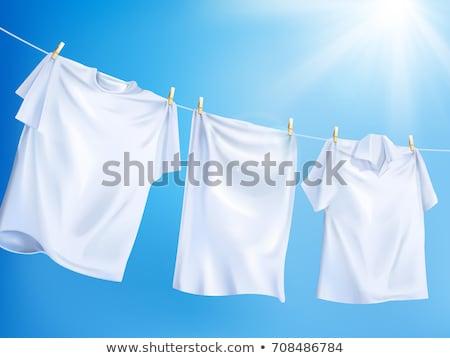 Zdjęcia stock: Ubrania · wiszący · rząd · kolorowy · plastikowe · świetle