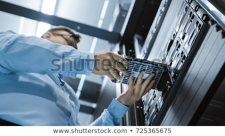 Technician installing a hard drive Stock photo © photography33