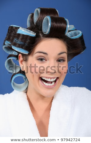 Laughing woman with her hair in Velcro rollers Stock photo © photography33
