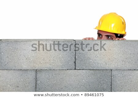 craftsman hiding behind a stone wall Stock photo © photography33
