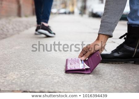 Rubare contanti carta fuori portafoglio rosso Foto d'archivio © gewoldi