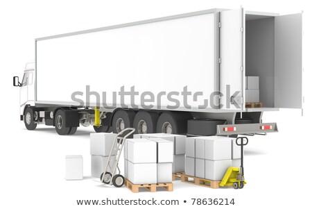 ストックフォト: Distribution Open Trailer With Pallets Boxes And Trucks Part Of A Blue And Yellow Warehouse And L
