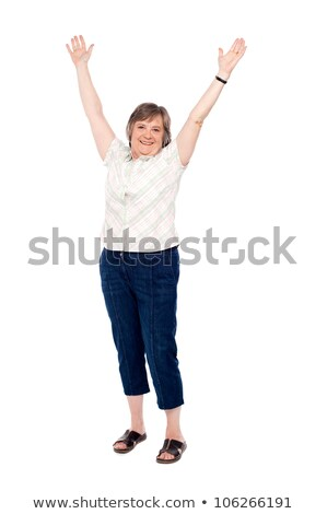 cheerful senior woman lifting her arms up stock photo © stockyimages