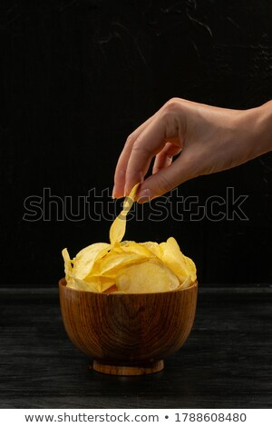 Putting in a potato pile. Stock photo © justinb