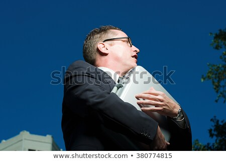 Man clutching a briefcase Stock photo © photography33
