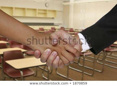 Student shaking teacher's hand Stock photo © photography33