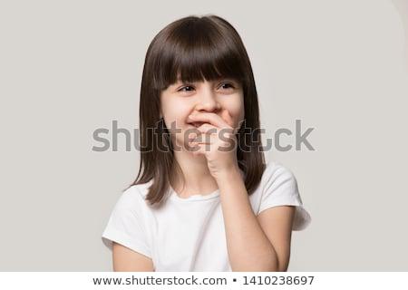 Portrait of bashful schoolgirl  Stock photo © grafvision
