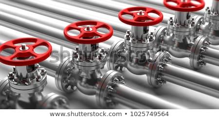 Metal pipe and a red valve, valve, valve. Industrial image stock photo © kolobsek