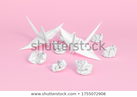 Origami crane and crumpled paper. Stock photo © snyfer