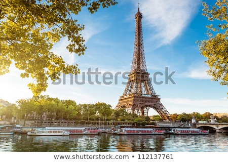 eiffel tower and bridge on seine river in paris france stock photo © photocreo