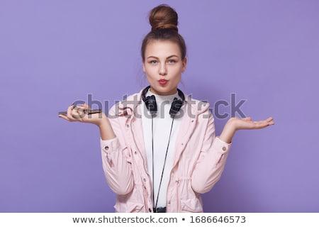 Güzel genç kadın kırmızı kulaklık kadın eğlence Stok fotoğraf © studio1901