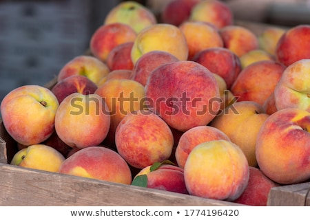 Peaches for sale at a marketplace Stock photo © stockyimages