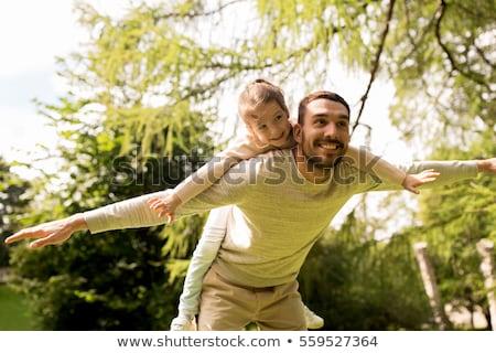 small girl having fun at park stock photo © taden