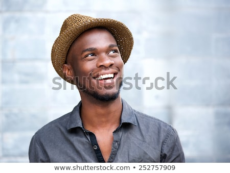 Handsome black man with cheerful attitude Stock photo © stepstock