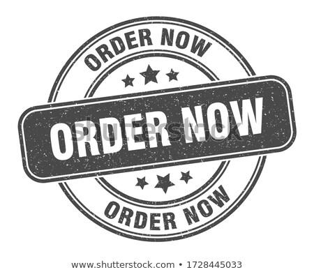 Order now stamp Stock photo © burakowski