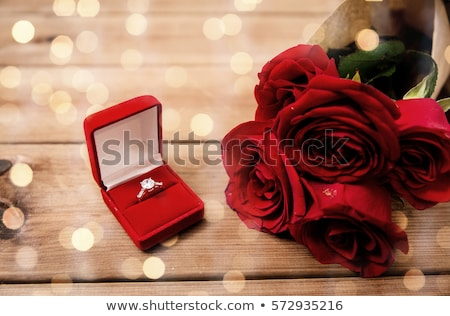 Diamond engagement ring in the heart of a red rose Stock photo © juniart