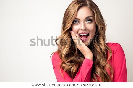 Beautiful expressive businesswoman. Stock photo © lithian
