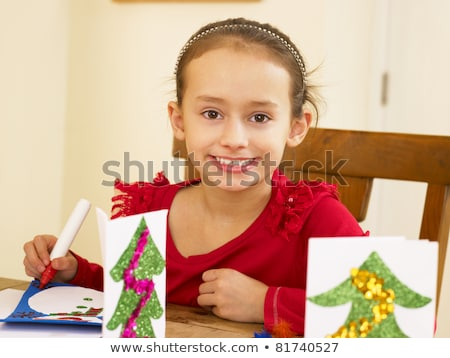 young mixed race child making christmas cards stock photo © monkey_business
