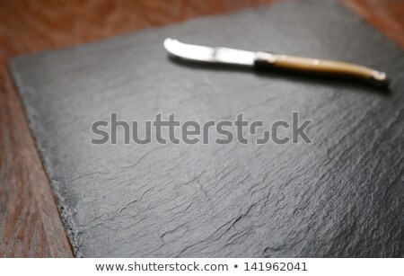 Cheeseboard and knife Stock photo © russwitherington