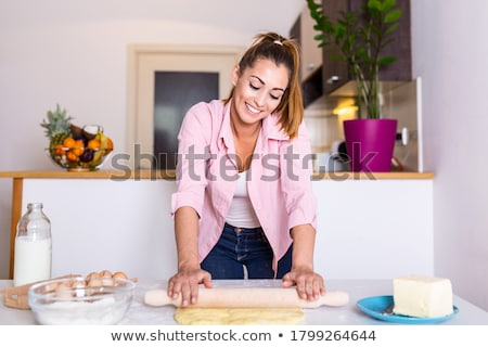Happy housewife with rolling pin Stock photo © Nejron