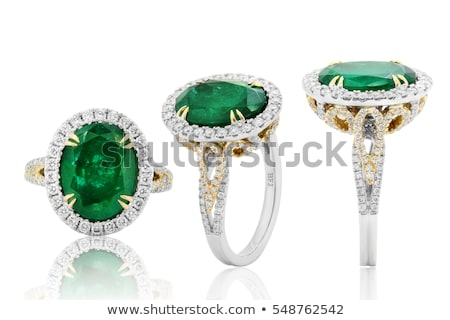 woman with diamond and emerald earrings Stock photo © dolgachov