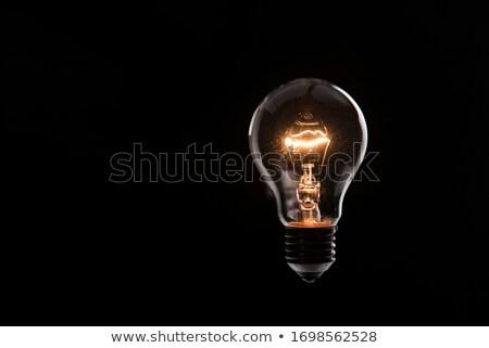 lit light bulb on black background stock photo © johny87