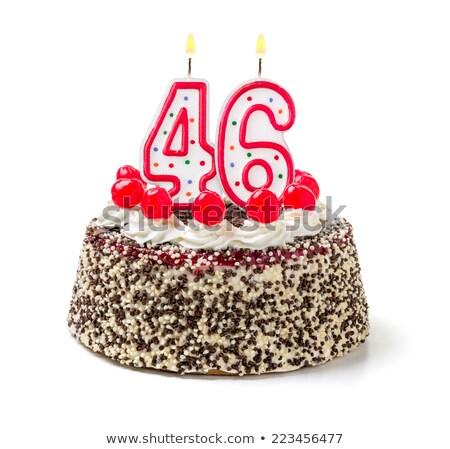Birthday cake with burning candle number 46 Stock photo © Zerbor