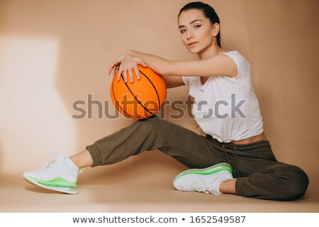 Woman in Workout Outfit Holding Basketball Ball Stock photo © dash