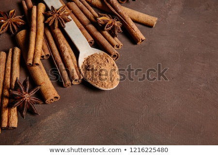 Cinnamon sticks with pure cane brown sugar on wood background Stock photo © joannawnuk