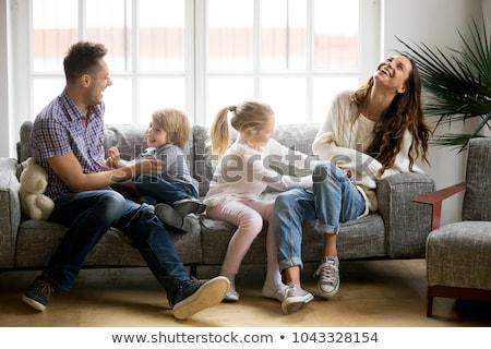 счастливым молодые Sweet пару сидят диване Сток-фото © juniart