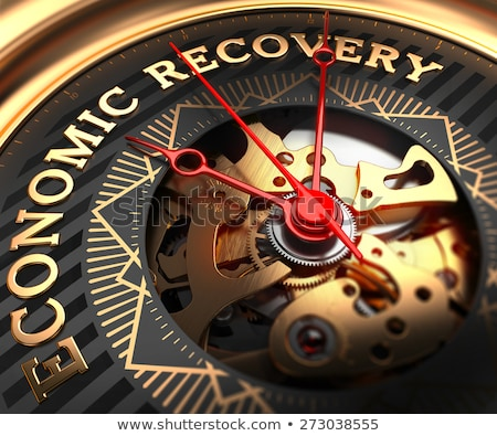 economic recovery on black golden watch face stock photo © tashatuvango