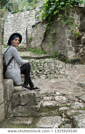 Attractive woman sits on staircase near road Stock photo © Aikon