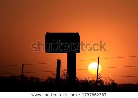 Mailbox silhouet zonsondergang avond vak Stockfoto © stoonn